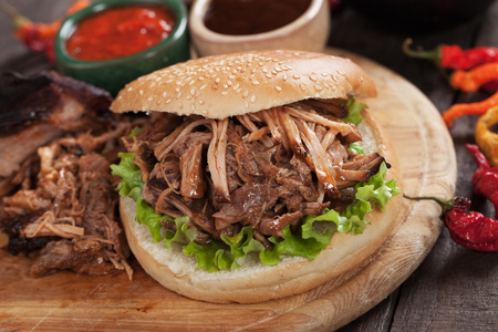 Pulled pork sandwich with ketchup and barbecue sauce Stock Photo