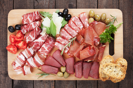 Charcuteri board with prosciutto, capicola and other italian deli cured meat