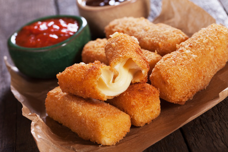 Breaded mozzarellla cheese sticks with ketchup and bbq sauce Stok Fotoğraf