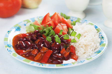 red cooked: Red kidney beans served with cooked rice and tomato salad