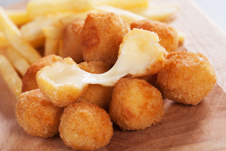 Breaded mozzarella cheese balls with french fries