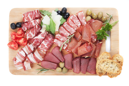 Charcuterie board with italian deli food isolated on white background