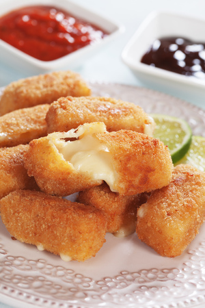 fried foods: Breaded mozzarella cheese sticks served with tomato sauce