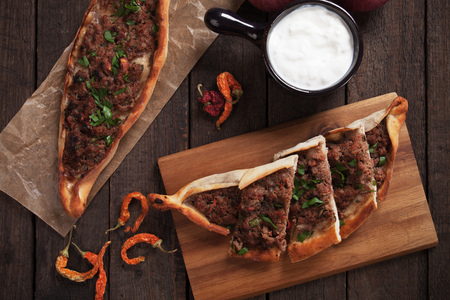Turkish pide, traditional meat and vegetable meal similar to pizza