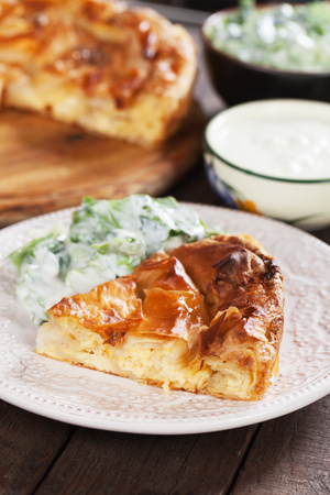 Phyllo pastry cheese pie served with salad and yoghurt