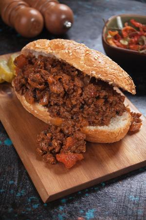 Sloppy Joes ground beef sandwich served on wooden board Stock Photo