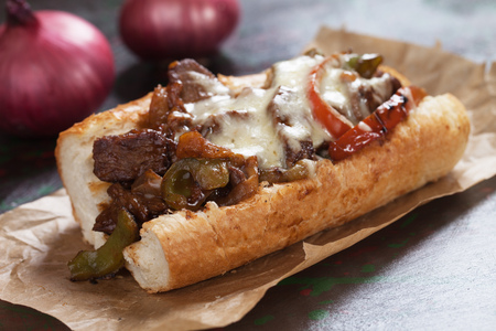 Philly cheese steak sandwich served on parchment paper