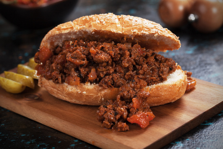 Sloppy joes, ground beef burger sandwich served on wooden board