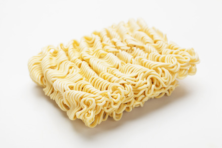 Raw asian instant noodles shot over white background Stock Photo