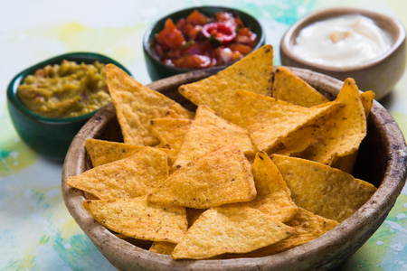 Nachos ,mexican meal with tortilla chips, salsa and guacamole