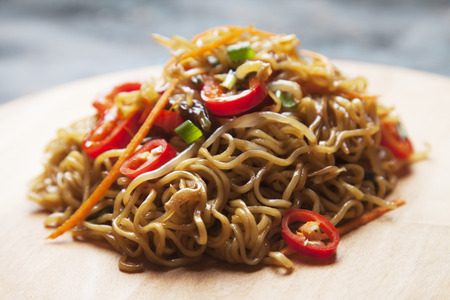 Fried asian instan noodles with bean sprouts, green onion and chili pepper Stock Photo