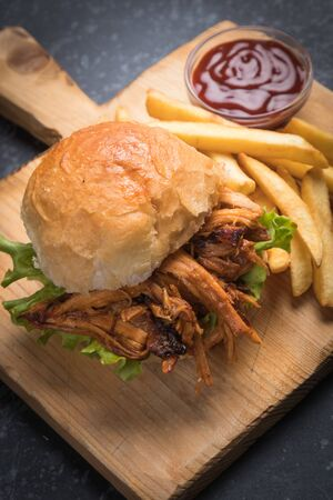 Burger with pulled pork, classic american meat sandwich