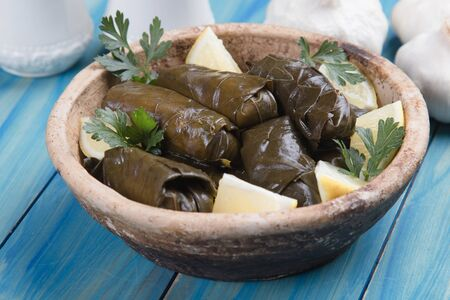 Stuffed grape leaves filled with rice or meat stuffing Imagens