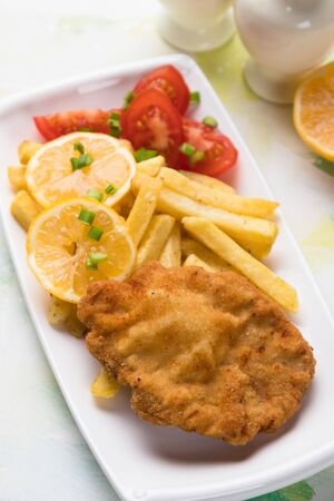Vienna steak, breaded and deep fried cutlet with french fries