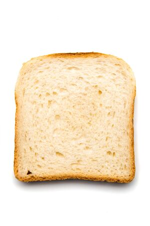 Slice of bread with spread on top isolated over white background