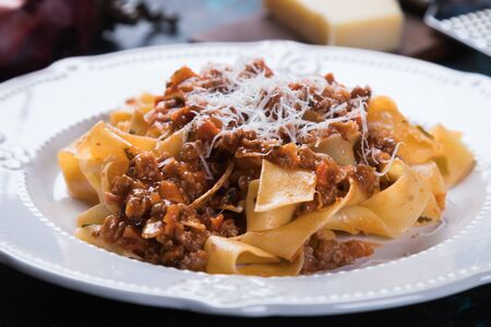 Ragu bolognese, italian ground beef sauce with fettuccine or pappardelle pasta Stock Photo