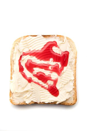 Slice of bread with butter and jelly spread on top isolated over white background