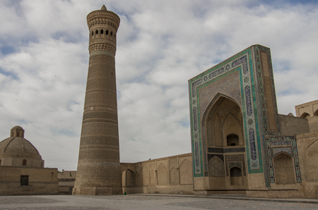 minaret: Kalon minaret and mosque in Bukhara Stock Photo