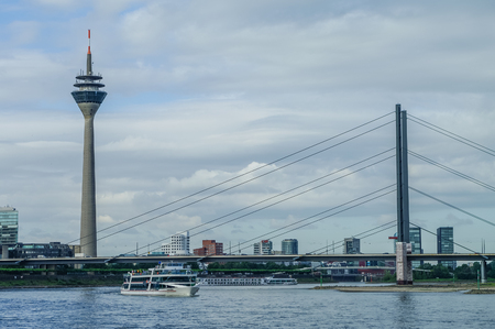 rhine westphalia: Cityscape of Dusseldorf over the Rhine river whith Rheinkniebrucke bridge and Rheinturm tower,ordrhein-Westfalen, Germany.