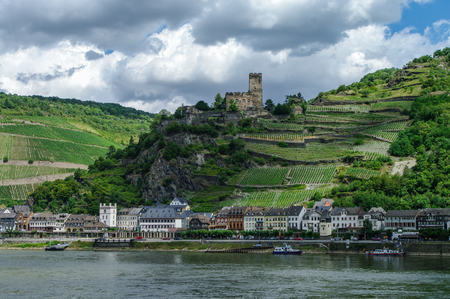 rudesheim: Romantic Gutenfels medieval castle at Kaub in the famous Rhine Gorge north of Rudesheim, Germany. The hills with the famous vineyards of the Rhine and medieval village on a sunny summer day. Editorial