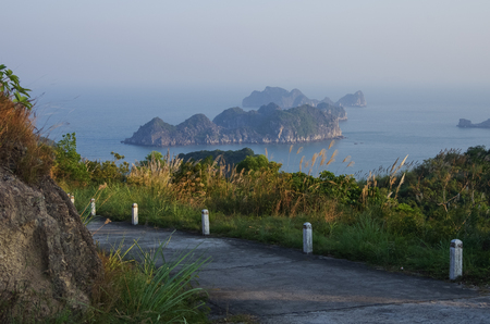 cat island: View to Ha Long bay from road to Cannon Fort of Cat Ba Island, Vietnam Stock Photo