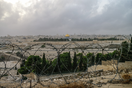 jerusalem: Panorama of Jerusalem with barbed wire in the foreground. Israel