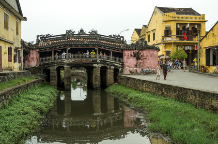vietnam culture: Hoi An, Vietnam - , Canal with Japanese Covered Bridge in the background, Hoi An, Vietnam
