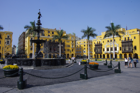 plaza de armas: Fountain in Plaza Mayor (formerly, Plaza de Armas) in Lima, Peru in sunny day.