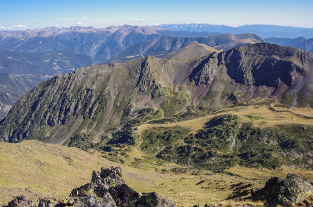 tourism in andorra: Panorama of the Pyrenees mountains in Andorra, from top of Coma Pedrosa peak.