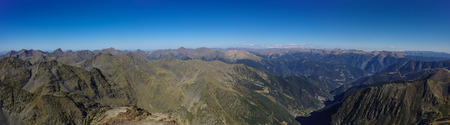pyrenean: Panorama of the Pyrenees mountains in Andorra, from top of Coma Pedrosa peak.