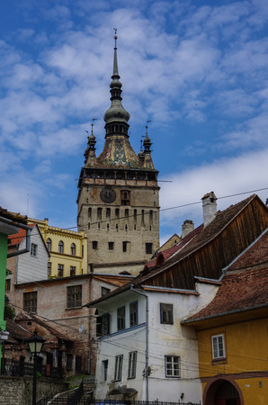 heritage protection: Clock tower and old houses of  medieval town of Sighisoara, Transylvania, Romania Stock Photo