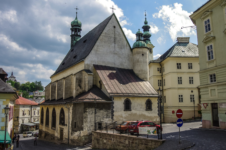 unesco: Banska Stiavnica ,Slovakia - May 4,2013: Town-hall and st. Katharine church, UNESCO monument Editorial
