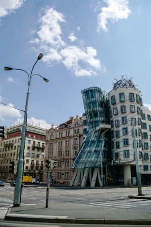 dancing house: Prague, Czech Republic - May 8, 2012: Modern building, also known as the Dancing House, designed by Vlado Milunic and Frank O. Gehry stands on the Rasinovo Nabrezi.