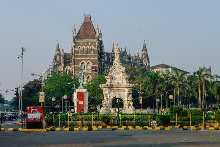 maharashtra: Flora Fountain and Oriental Old Building at blue sky in sunny at fort area in Mumbai, Maharashtra, India