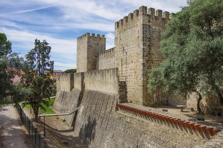 moat wall: External wall, moat and towers of the Lisbon Castle (Castelo de Sao Jorge). Lisbon, Portugal