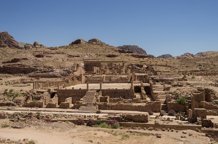 colonnaded: View of The Great Temple and Arched Gate in ancient city Petra, Jordan