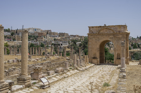 antiquity: Columns in Colonnaded Street and Northern Tetrapylon at background, Ancient Roman city of Gerasa of Antiquity , modern Jerash, Jordan