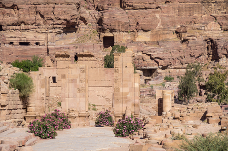 colonnaded: The Hadrian (Temenos) Gate and the Cardo Maximus in Petra. Qasr al-Bint at background. Petra, Jordan Stock Photo