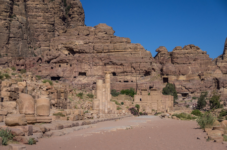 colonnaded: The Hadrian Gate and the Cardo Maximus in Petra. Qasr al-Bint at background. Petra, Jordan