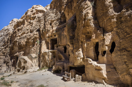 nabatean: Cave tombs in Nabataean city of the Siq al-Barid in Jordan. It is known as the Little Petra Stock Photo