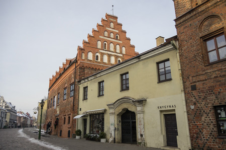 kaunas: Kaunas, Lithuania - January 3, 2016: Street view of Kaunas old city with brick medieval traditional houses.