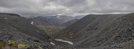 mosses: Panorama of mountain valley with mosses and rocks covered with lichens. Cloudy sky before storm.  Khibiny mountains above the Arctic circle, Kola peninsula, Russia