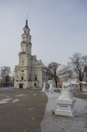 town hall square: Kaunas, Lithuania - January 3, 2016: Town hall and town hall square with christmas market and statue. Stock Photo