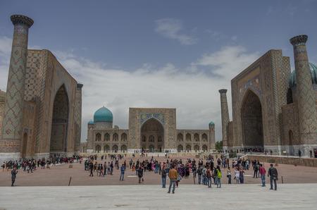 registan: Samarkand, Uzbekistan - April 26, 2015: People in The Registan square.