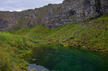 Asbyrgi canyon in Jokulsargljufur national park and green lake with refflection, Iceland.