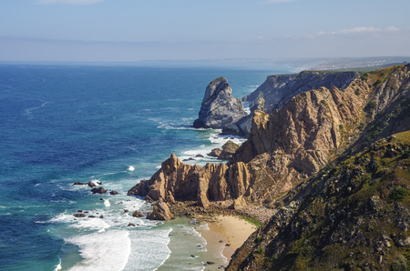 Atlantic ocean coastline view from Cabo da Roca (Cape Roca) is a cape which forms the westernmost extent of mainland Portugal and continental Europe. Portugal Stock Photo