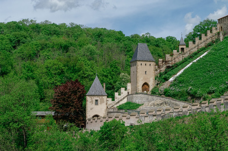 Towers and walls of famous medieval Karlstejn castle near Prague in Czech Republic Editorial