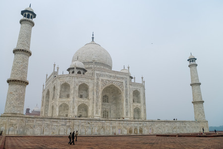 The Taj Mahal is an ivory-white marble mausoleum on the south bank of the Yamuna river in the Indian city of Agra, Uttar Pradesh. India Stock Photo