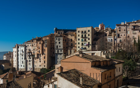 View to hanging houses of Cuenca old town. Outstanding example of a medieval city, built on the steep sides of a mountain. Many casas colgadas are built right up to the cliff edge. Cuenca, Spain Stock Photo