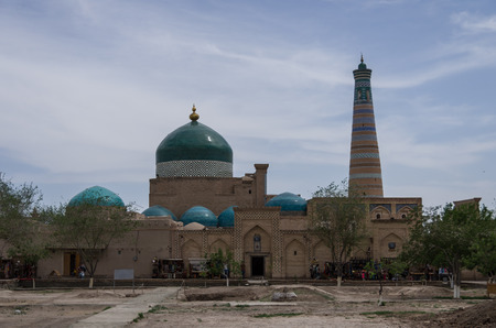 uzbek: View of  Pahlavon Mahmud Mausoleum and Islam Khodja minaret, Khiva, Uzbekistan.